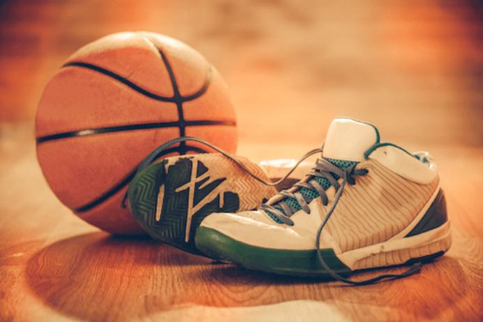 Basketball and white basketball shoes
