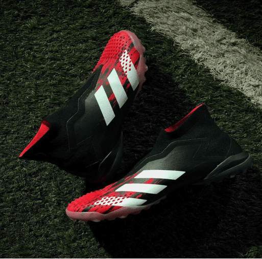 Red and black football boots